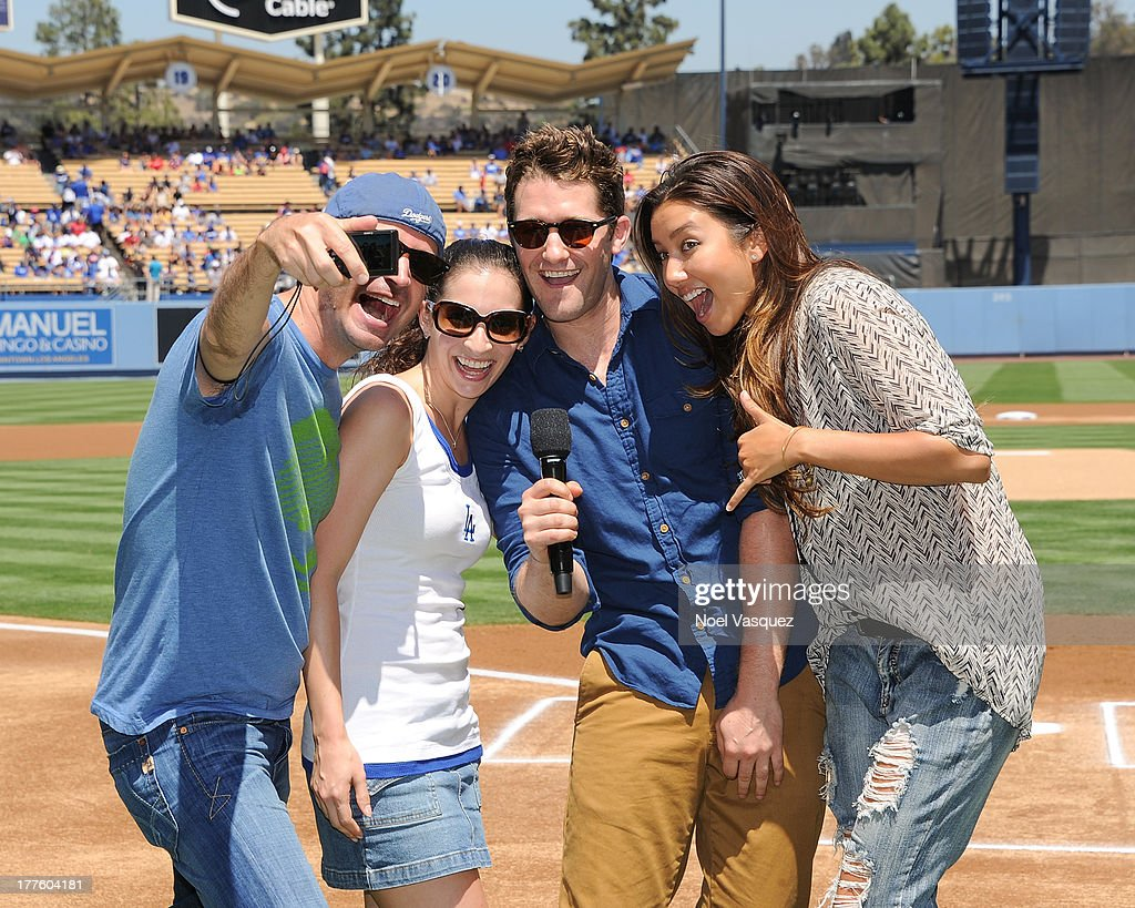 Matthew Morrison his fiancee Renee Puente and friends attend a baseball game between the Boston Red Sox and Los Angeles Dodgers at Dodger Stadium on...
