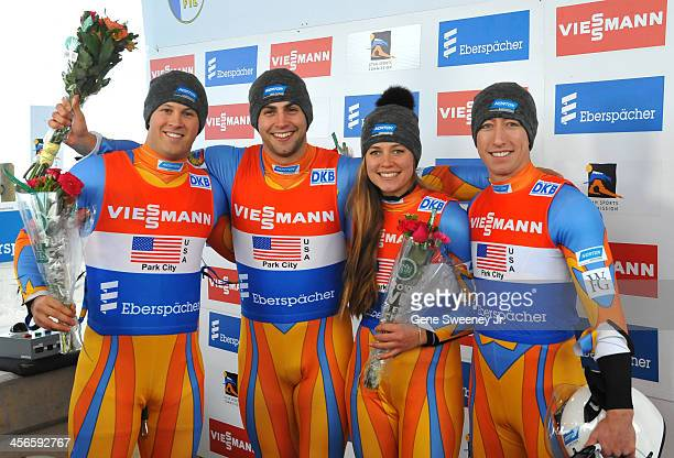 Matthew Mortensen Chris Mazdzer Kate Hansen and Preston Griffall of the United States pose for their podium photo after finishing second in the Team...