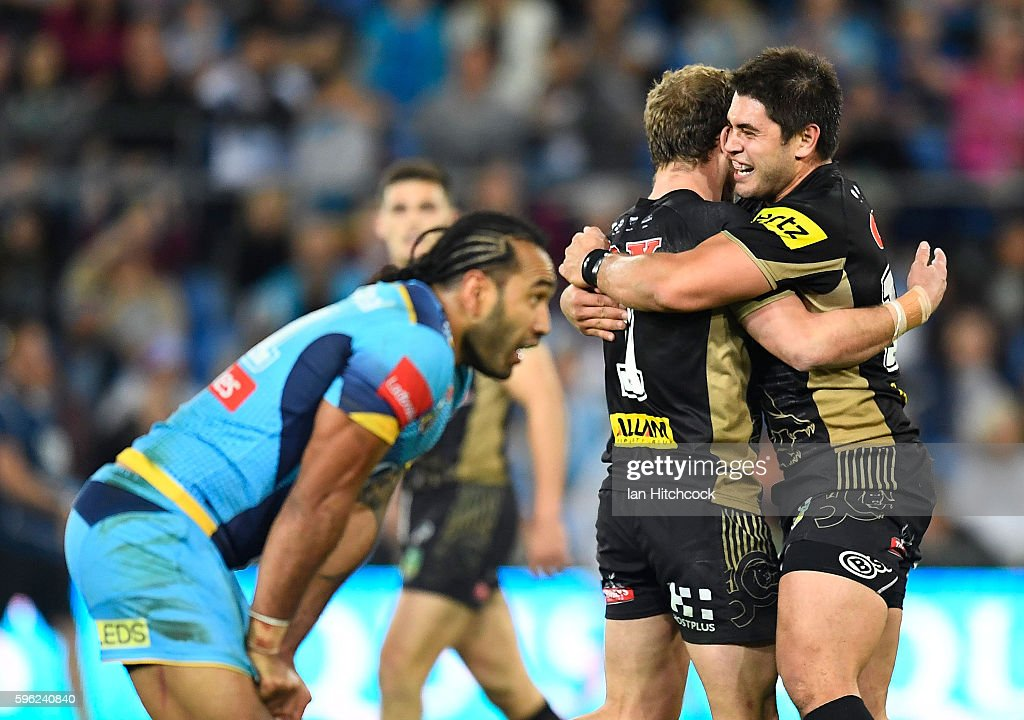 Matthew Moylan of the Panthers celebrates with Christopher Grevsmuhl of the Panthers after kicking the winning field goal during the round 25 NRL match between the Gold Coast Titans and the Penrith Panthers at Cbus Super Stadium on August 27, 2016 in Gold Coast, Australia.