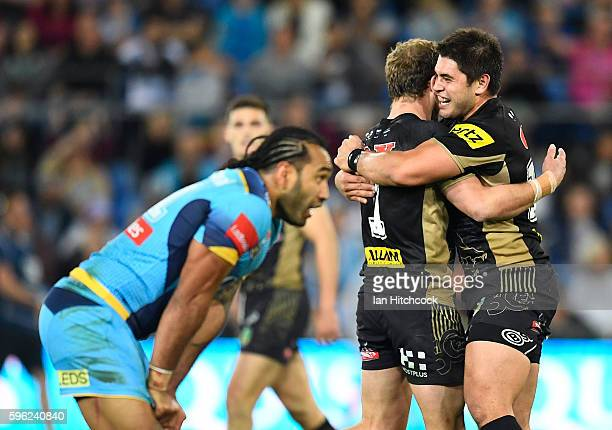Matthew Moylan of the Panthers celebrates with Christopher Grevsmuhl of the Panthers after kicking the winning field goal during the round 25 NRL...