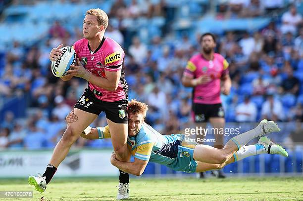 Matthew Moylan of the Panthers is tackled by Kane Elgey of the Titans during the round seven NRL match between the Gold Coast Titans and the Penrith...