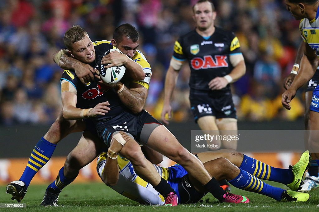 Matthew Moylan of the Panthers is tackled during the round seven NRL match between the Penrith Panthers and the Parramatta Eels at Centrebet Stadium on April 29, 2013 in Penrith, Australia.