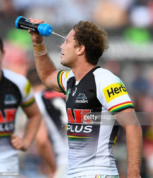 Matthew Moylan of the Panthers sprays water in his face during the round 16 NRL match between the North Queensland Cowboys and the Penrith Panthers...
