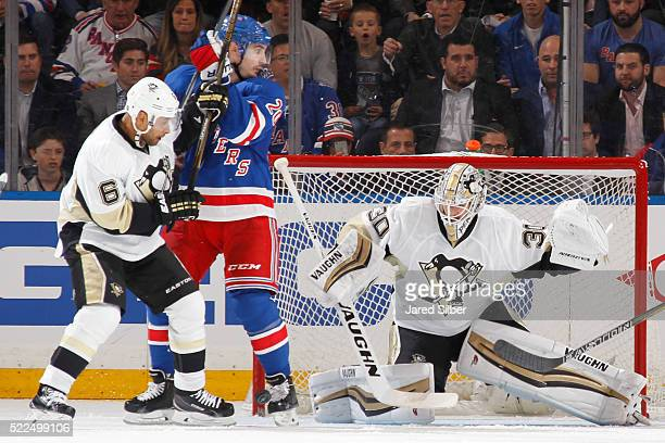Matthew Murray of the Pittsburgh Penguins makes a save after a redirection by Chris Kreider of the New York Rangers in front of the net in Game Three...