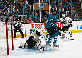 Matthew Murray of the Pittsburgh Penguins makes the save despite Joel Ward of the San Jose Sharks screening his view in Game Three of the 2016 NHL...