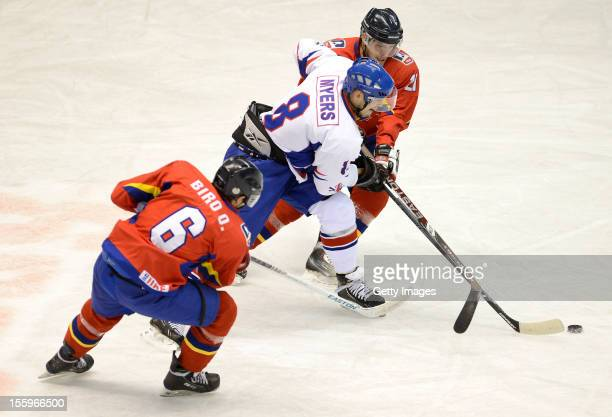 Matthew Myers of Great Britain skates against Otto Biro and Ede Mihaly of Romania during the Ice Hockey Sochi Olympic PreQualification Group J match...