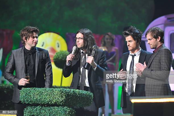 Matthew Nathan Jared and Caleb Followill of the Kings of Leon accepting an award on stage at the 2009 Brit Awards held at Earls Court on February 18...