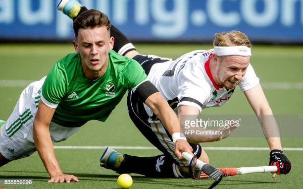 Matthew Nelson of Ireland fights for the ball with Christopher Ruhr of Germany during the men's Rabo EuroHockey Championships 2017 match between...
