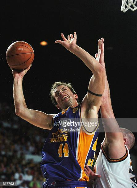 Matthew Nielsen of the Kings drives to the basket over David Pennisi of the Razorbacks during NBL Finals match between Sydney Kings and Sydney...