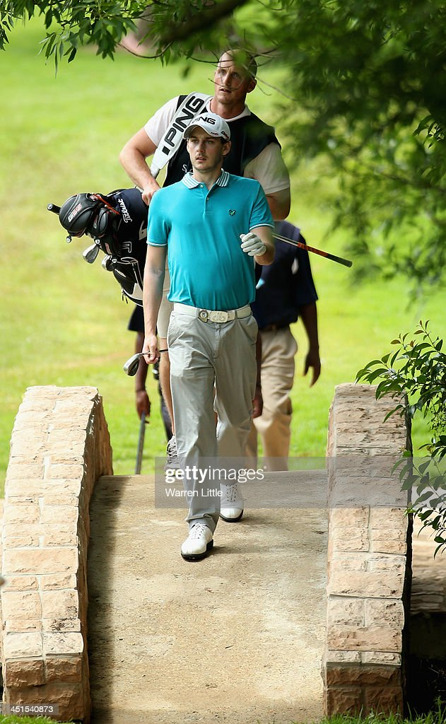 Matthew Nixon of England crosses a bridge during the third round of the South African Open Championship at Glendower Golf Club on November 23, 2013 in Johannesburg, South Africa.