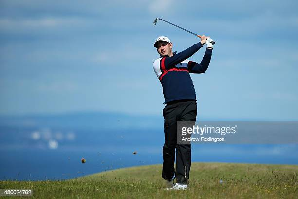 Matthew Nixon of England hits his second shot on the 13th hole during the first round of the Aberdeen Asset Management Scottish Open at Gullane Golf...