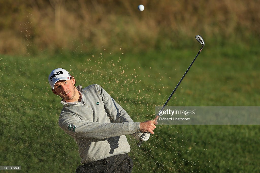 Matthew Nixon of England plays from a greenside bunker on the 18th during the final round of the European Tour Qualifying School Finals at PGA Catalunya Resort on November 29, 2012 in Girona, Spain.