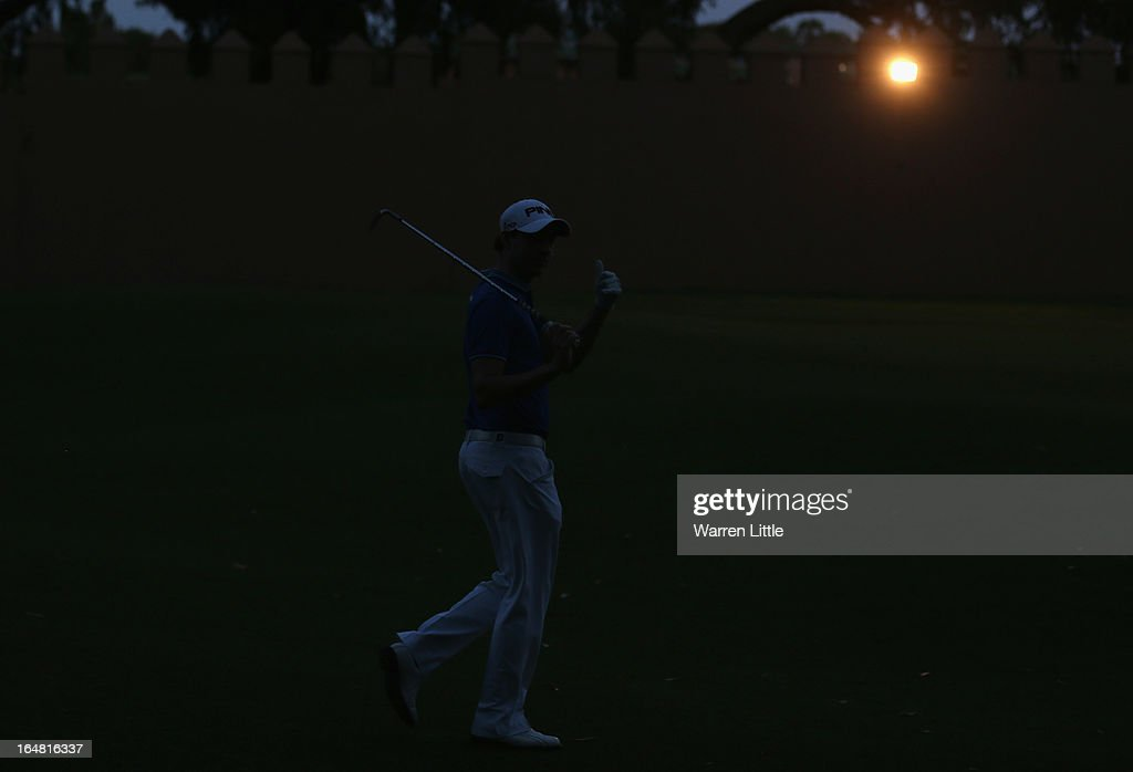 Matthew Nixon of England walks up the ninth fairway as light fades during the first round of the Trophee du Hassan II Golf at Golf du Palais Royal on March 28, 2013 in Agadir, Morocco.