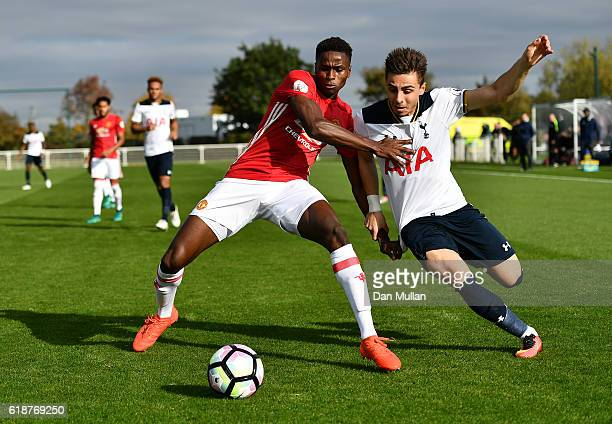 Matthew Olosunde of Manchester United battles for the ball with Anthony Georgiou of Tottenham Hotspur during the Premier League Two match between...