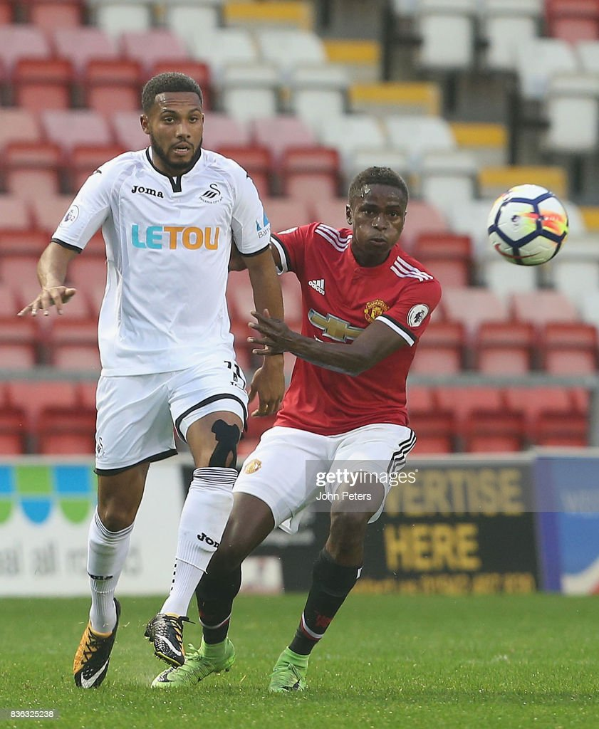 Matthew Olosunde of Manchester United U23s in action with Kenji Gorre of Swansea City during the Premier League 2 match between Manchester United U23s and Swansea City U23s at Leigh Sports Village on August 21, 2017 in Leigh, Greater Manchester.