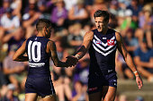 Matthew Pavlich and Michael Walters of the Dockers celebrate a goal during the NAB Challenge match between the Fremantle Dockers and the Melbourne...