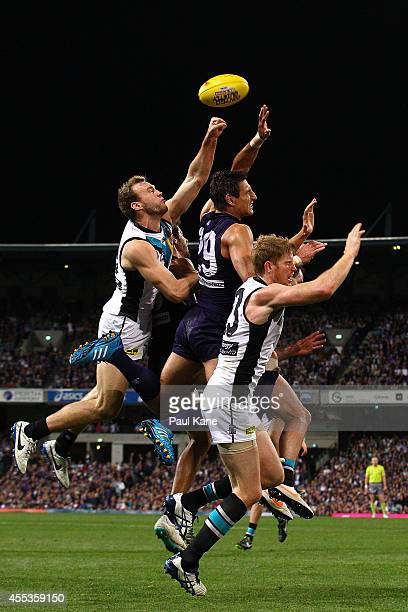 Matthew Pavlich of the Dockers contests a mark against Jack Hombsch and Matthew Lobbe of the Power during the AFL 1st Semi Final match between the...
