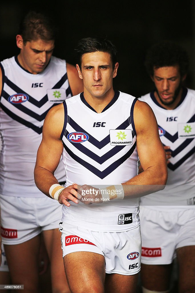 <a gi-track='captionPersonalityLinkClicked' href=/galleries/search?phrase=Matthew+Pavlich&family=editorial&specificpeople=208649 ng-click='$event.stopPropagation()'>Matthew Pavlich</a> of the Dockers leads his team onto the field during the round eight AFL match between the Port Adelaide Power and Fremantle Dockers at Adelaide Oval on May 10, 2014 in Adelaide, Australia.