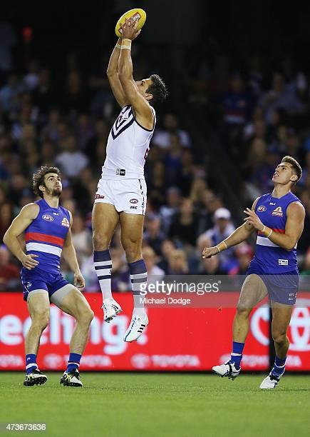 Matthew Pavlich of the Dockers marks the ball next to Easton Wood of the Bulldogs during the round seven AFL match between the Western Bulldogs and...