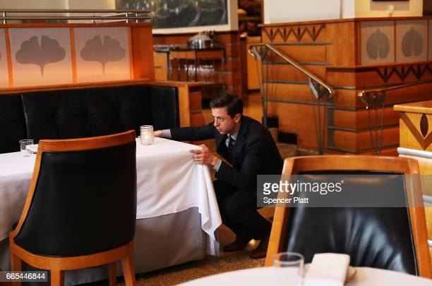 Matthew Pene Maitre d' at Eleven Madison Park checks the dining room before dinner on April 6 2017 in New York City The esteemed restaurant has...