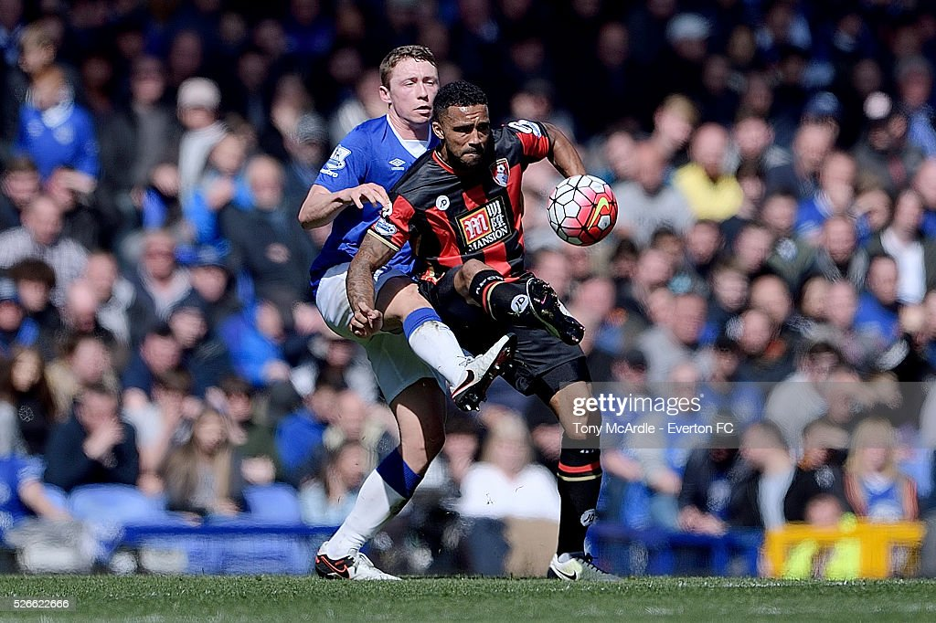 Matthew Pennington of Everton challenges Joshua King of Bournemouth during the Barclays Premier League match between Everton and A.F.C. Bournemouth at Goodison Park on April 30, 2016 in Liverpool, England.