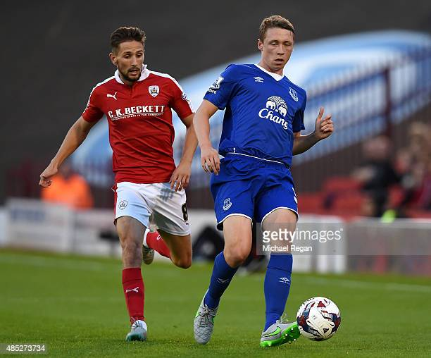 Matthew Pennington of Everton is closed down by Conor Hourihane of Barnsley during the Capital One Cup second round match between Barnsley and...