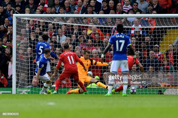 Matthew Pennington scores during the Premier League match between Liverpool and Everton at Anfield on April 1 2017 in Liverpool England