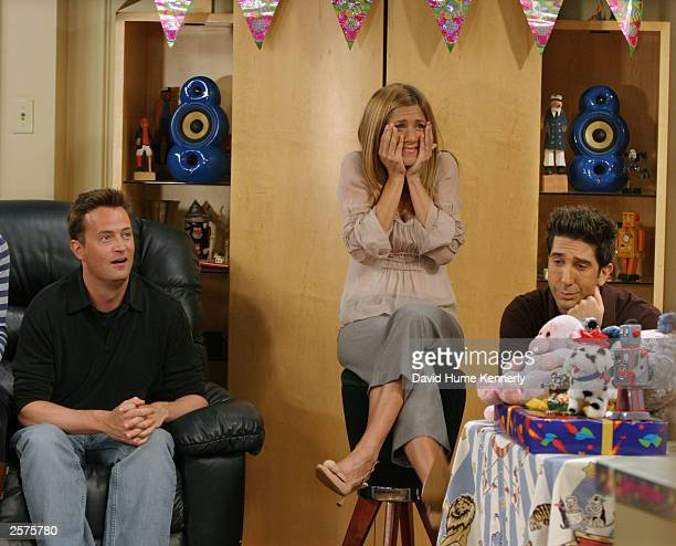 Matthew Perry Jennifer Aniston and David Schwimmer cast members of the hit NBC series 'Friends' react during a scene on one of their last shows on...