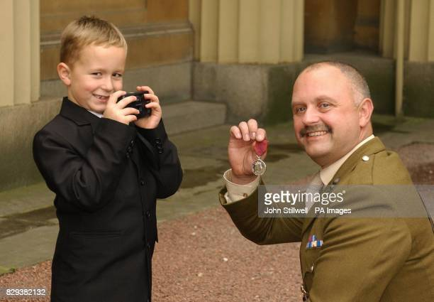 Matthew Pettit takes a picture of his father former Regimental Sergeant Major Nicholas Pettit of the Royal Engineers and the George Medal he received...