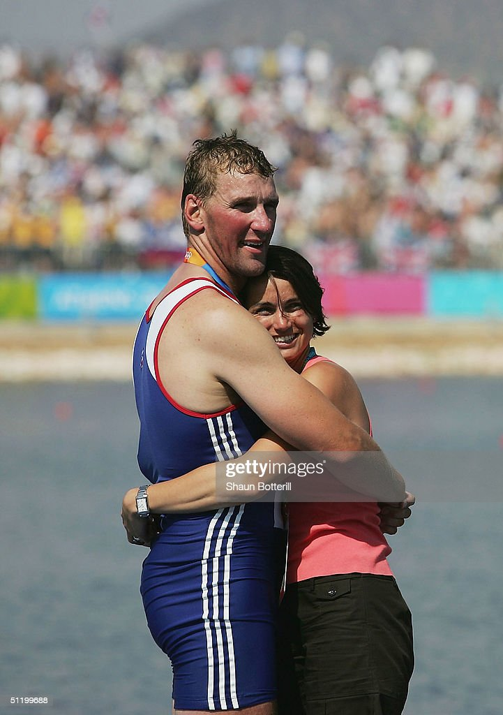 Matthew Pinsent gets a hug from his wife Dee Pinsent after receiving his Gold medal for winning the men's four rowing event on August 21, 2004 during the Athens 2004 Summer Olympic Games at the Schinias Olympic Rowing and Canoeing Centre in Athens, Greece.