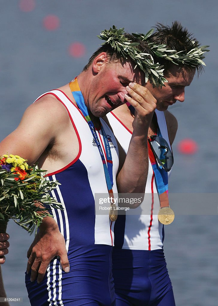 Matthew Pinsent (L)of Great Britain, standing next to his teammate Ed Coode, cries after winning the Gold medal in the men's four final on August 21, 2004 during the Athens 2004 Summer Olympic Games at the Schinias Olympic Rowing and Canoeing Centre in Athens, Greece.