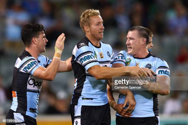 Matthew Prior of the Sharks celebrates scoring a try with team mates during the round two NRL match between the Canberra Raiders and the Cronulla...