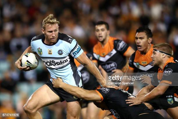 Matthew Prior of the Sharks makes a break during the round nine NRL match between the Wests Tigers and the Cronulla Sharks at Leichhardt Oval on...