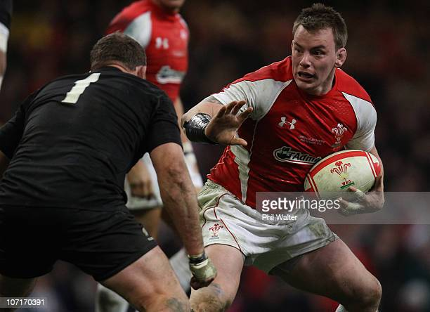 Matthew Rees of Wales fends off Tony Woodcock of the All Blacks during the Test match between Wales and the New Zealand All Blacks at Millennium...