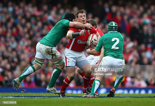 Matthew Rees of Wales is tackled by Sean O'Brien of Ireland during the RBS Six Nations match between Wales and Ireland at the Millennium Stadium on...