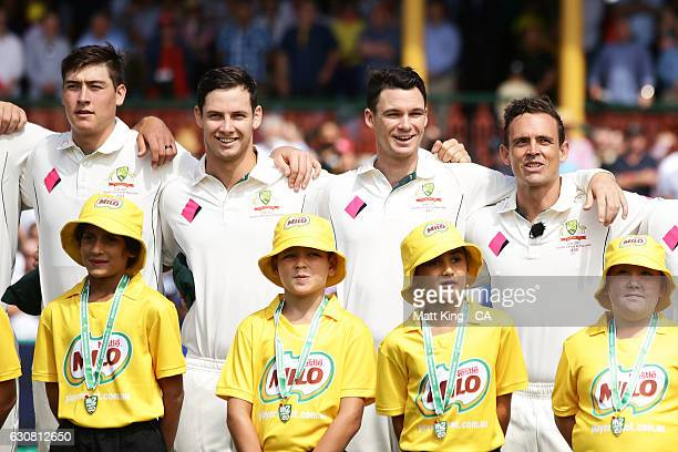Matthew Renshaw Hilton Cartwright Peter Handscomb and Steve O'Keefe of Australia line up for the national anthems during day one of the Third Test...
