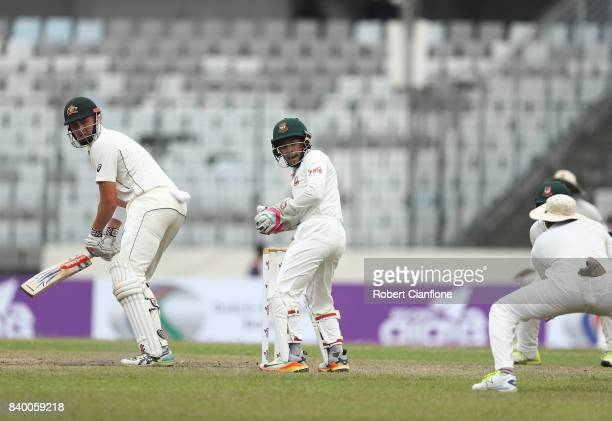 Matthew Renshaw of Australia is caught at slip by Soumya Sarkar of Bangladesh off the bowling of Shakib Al Hasan during day two of the First Test...