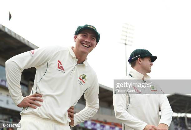 Matthew Renshaw of Australia laughs as he prepares to take to the field for the second innings during day two of the First Test match between...