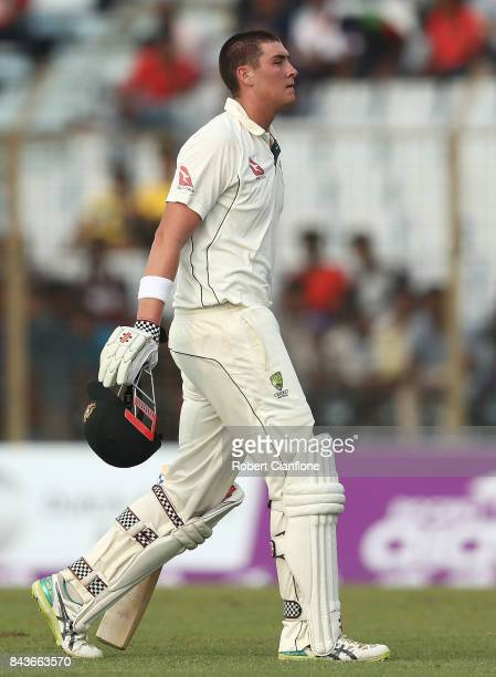 Matthew Renshaw of Australia walks off after he was dismissed by Shakib Al Hasan of Bangladesh during day four of the Second Test match between...