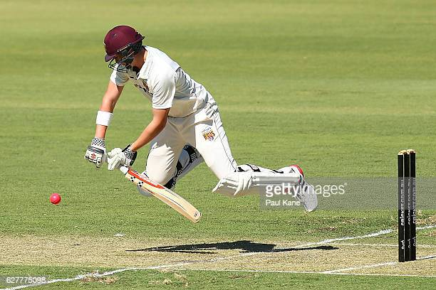 Matthew Renshaw of Queensland slips wihile playing a shot during day one of the Sheffield Shield match between Western Australia and Queensland at...