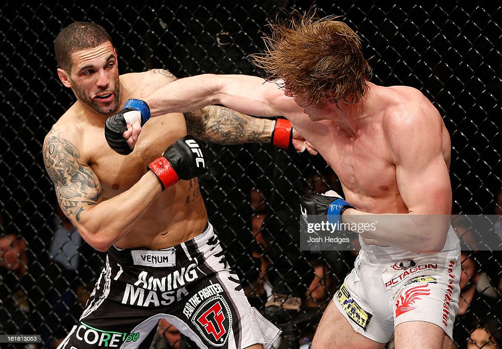 Matthew Riddle punches Che Mills in their welterweight fight during the UFC on Fuel TV event on February 16, 2013 at Wembley Arena in London, England.