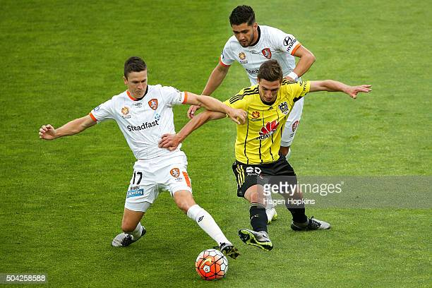 Matthew Ridenton of the Phoenix attempts to win the ball from Matt McKay and Dimitri Petratos of the Roar during the round 14 ALeague match between...