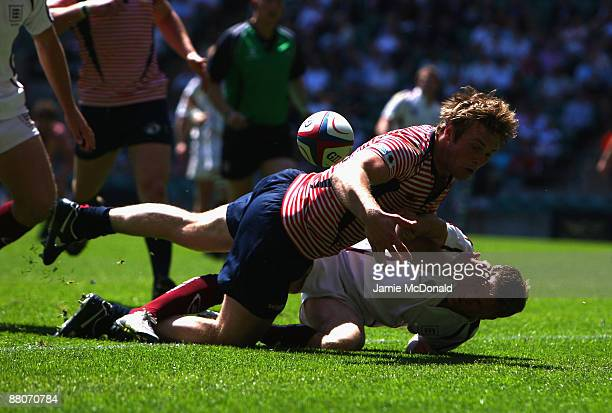 Matthew Riley of Lancashire is tackled by Mark Woodrow of Gloucestershire during the Bill Beaumont Cup Final between Gloucestershire and Lancashire...