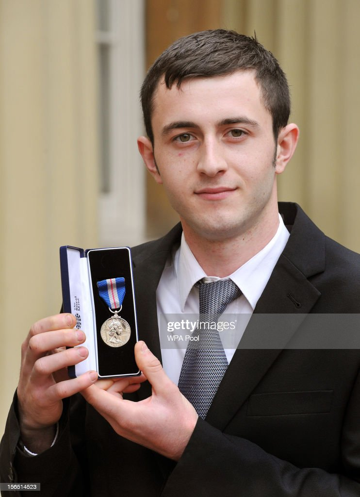 Matthew Robinson proudly holds his Queen's Gallantry Medal, after it was presented to him by Queen Elizabeth II, at the Investiture ceremony at Buckingham Palace on November 16, 2012 in London, England.