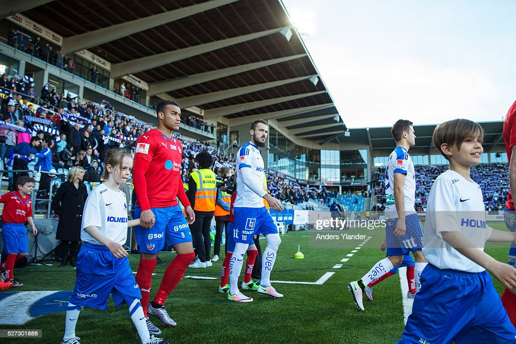 Matthew Rusike of Helsingborgs IF and Emir Kujovic of IFK Norrkoping entering the arena during the Allsvenskan match between IFK Norrkoping and Helsingborgs IF at Ostgotaporten on May 2, 2016 in Norrkoping, Sweden.