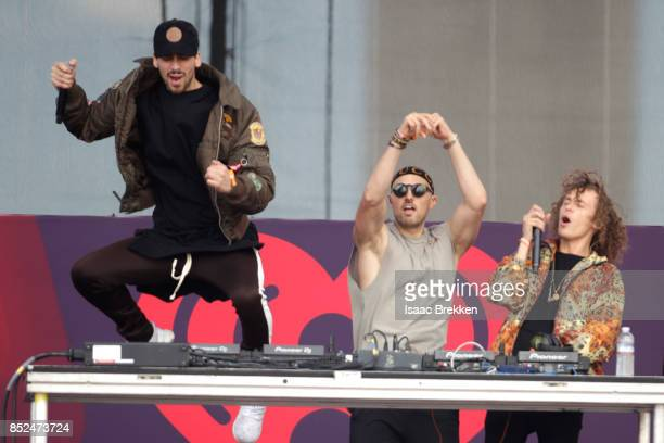 KEVI Matthew Russell and Trevor Dahl of Cheat Codes perform onstage during the Daytime Village Presented by Capital One at the 2017 HeartRadio Music...