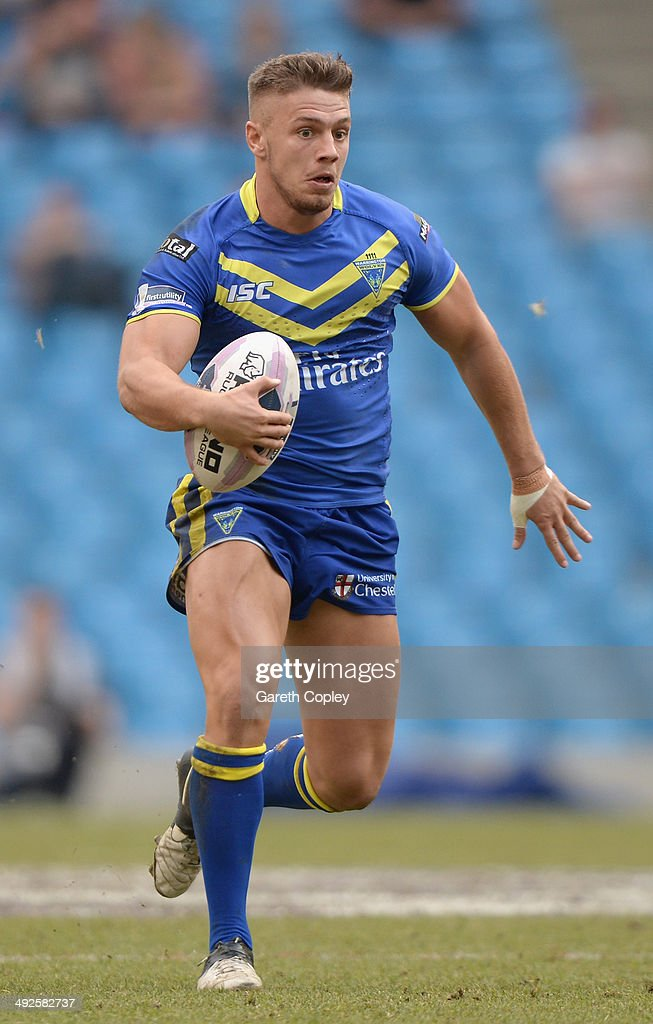 Matthew Russell of Warrington Wolves in action during the Super League match between Warrington Wolves and St Helens at Etihad Stadium on May 18, 2014 in Manchester, England.
