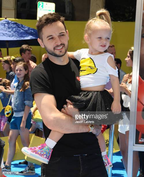 Matthew Rutler and daughter Summer Rain Rutler attend the premiere of 'The Emoji Movie' at Regency Village Theatre on July 23 2017 in Westwood...