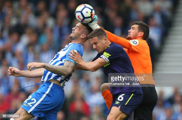 Matthew Ryan of Brighton and Hove Albion punches the ball away as Shane Duffy and Phil Jagielka of Everton collide during the Premier League match...
