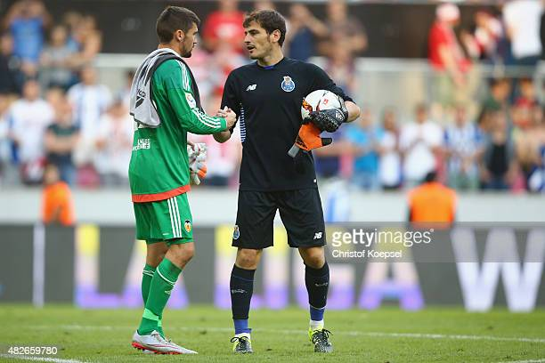 Matthew Ryan of Valencia congratulates Iker Casillas of Porto after saving the decision penalty during the Colonia Cup 2015 match between FC Valencia...